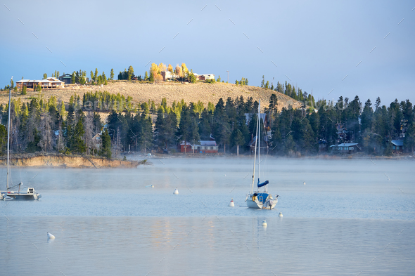 Foggy misty lake landscape in Colorado, USA - Stock Photo - Images