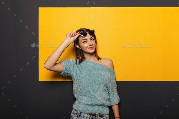 Fashion portrait of an appealing, stylish woman with sunglasses - Stock Photo - Images