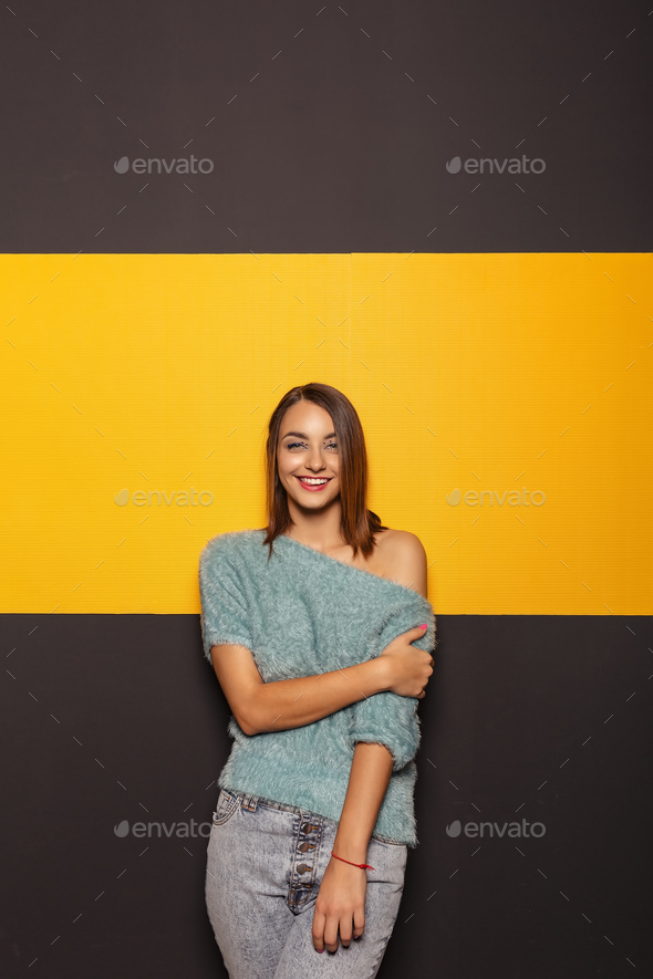 Pretty young lady fooling around in studio - Stock Photo - Images