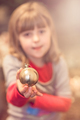 Cute girl holding Christmas decoration - PhotoDune Item for Sale