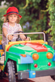 Little girl driving a toy car - PhotoDune Item for Sale