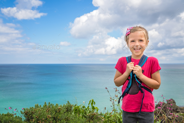 Cute happy little girl on the Cornish coast - Stock Photo - Images