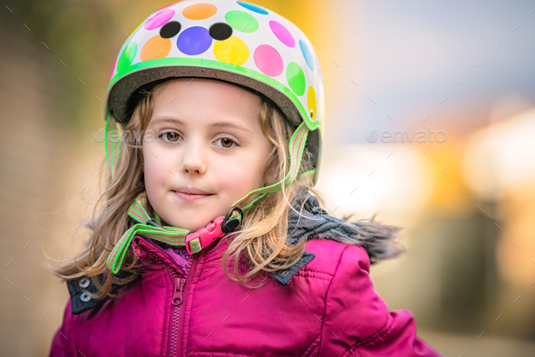 Young girl wearing cycle helmet - Stock Photo - Images