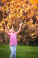 Girl catching leaves in autumn - PhotoDune Item for Sale