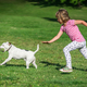 Girl chasing after dog in park - PhotoDune Item for Sale