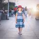 Little girl walking on a seaside promenade - PhotoDune Item for Sale