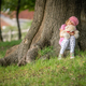 Girl sitting under a tree holding teddy bear - PhotoDune Item for Sale
