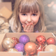Cute girl and a box of Christmas decorations - PhotoDune Item for Sale
