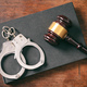 Handcuffs, gavel on book on a wooden background. - PhotoDune Item for Sale