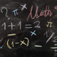 Math equations and symbols, isolated, on blackboard background. - PhotoDune Item for Sale