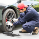 Mechanic replacing lug nuts changing tires on vehicle-3 - PhotoDune Item for Sale
