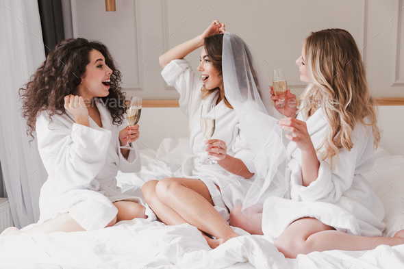 Portrait of pretty three women 20s celebrating bachelorette part - Stock Photo - Images