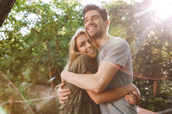 Happy lovely couple posing together and hugging to each other - Stock Photo - Images