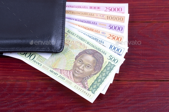 Malagasy Ariary in the black wallet  - Stock Photo - Images