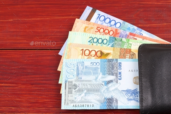 Kazakhstani tenge in the black wallet  - Stock Photo - Images
