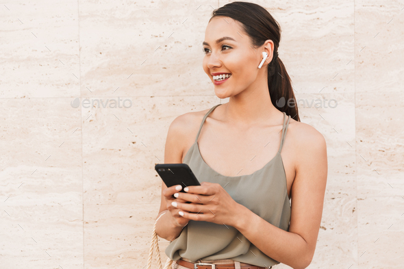 Portrait of smiling brunette woman wearing casual summer clothin - Stock Photo - Images