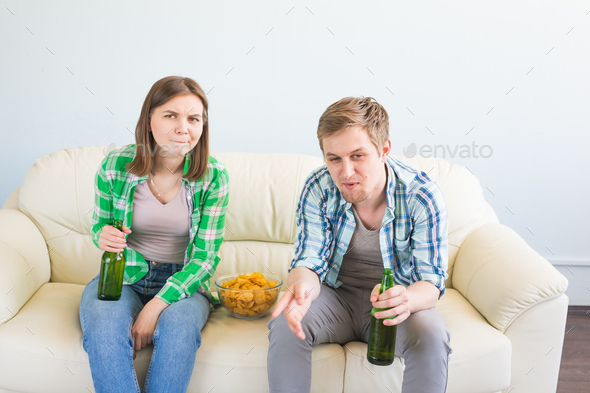 Sad friends or football fans watching soccer on tv. Losing a favorite team - Stock Photo - Images