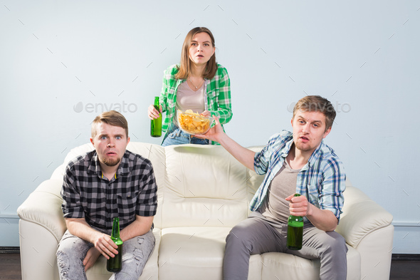 Soccer world cup, friends with chips and beer watching sports at home Stock Photo by Satura_