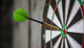 a typical darts game with dart in the bullseye - PhotoDune Item for Sale