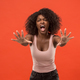The young emotional angry woman screaming on red studio background - PhotoDune Item for Sale
