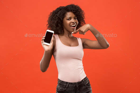 Portrait of a confident casual afro girl showing blank screen - Stock Photo - Images