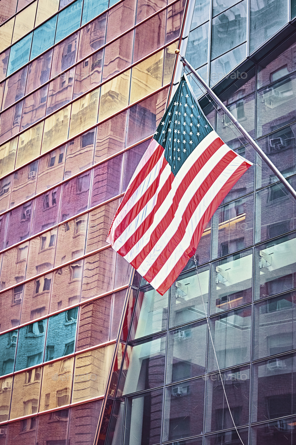 American flag in front of a modern building, New York. - Stock Photo - Images