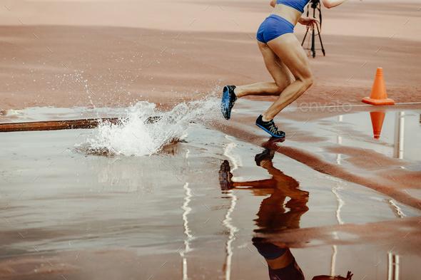 steeplechase female athlete - Stock Photo - Images