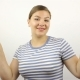 Beautiful Young Woman Showing Victory Sign and Smiling. - VideoHive Item for Sale