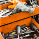 Open orange metal tool box with assorted tools - PhotoDune Item for Sale