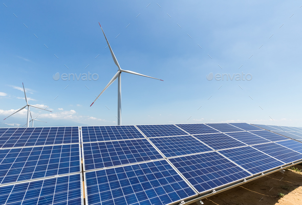 solar panel and wind turbine against a clear sky - Stock Photo - Images