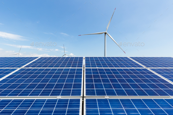solar panel and wind turbine against a clear sky, clean energy landscape - Stock Photo - Images