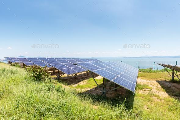solar panels on lakeside - Stock Photo - Images