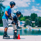 Senior man, teacher of roller skating with little boy - PhotoDune Item for Sale