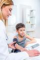 Pediatrician measuring boy's blood pressure - PhotoDune Item for Sale