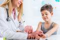 Pediatrician measuring boy's heart rate - PhotoDune Item for Sale