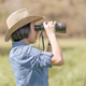 Woman wear hat and hold binocular in grass field-6 - PhotoDune Item for Sale