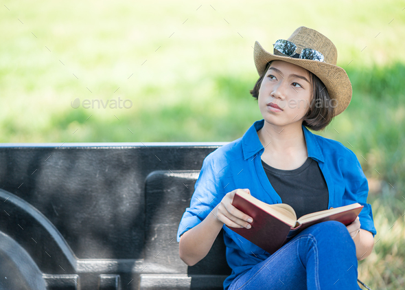Woman wear hat and reading the book on pickup truck-13 - Stock Photo - Images