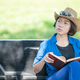 Woman wear hat and reading the book on pickup truck-13 - PhotoDune Item for Sale
