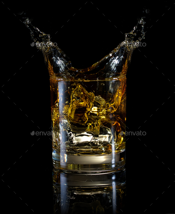 A glass of whiskey and splash - Stock Photo - Images