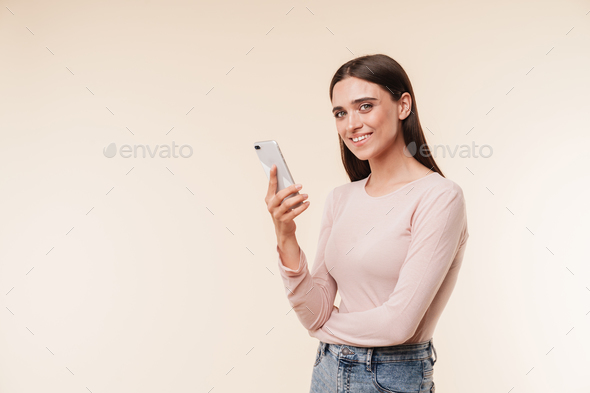 Portrait of a smiling young brunette girl - Stock Photo - Images