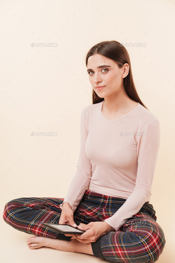 Pretty young brunette girl dressed in pajamas - Stock Photo - Images