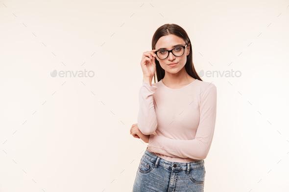 Portrait of a confident young brunette woman - Stock Photo - Images