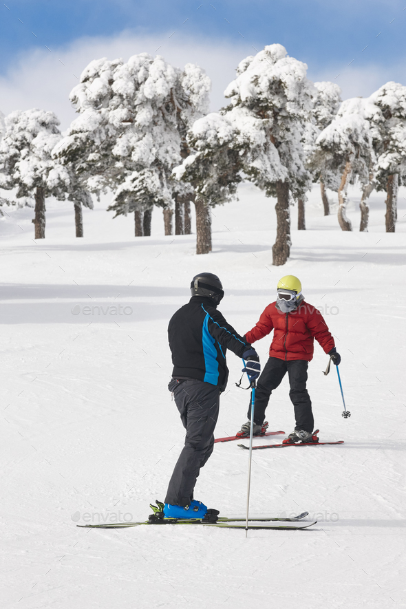 People skiing on a forest slope. White mountain landscape. Winter sport - Stock Photo - Images