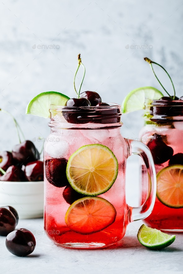 Cherry Limeade or Lemonade in glass mason jar. Ice cold summer drink. - Stock Photo - Images