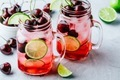 Cherry Limeade or Lemonade in glass mason jar. Ice cold summer drink. - PhotoDune Item for Sale