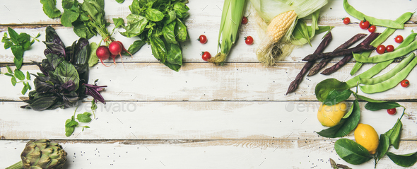 Healthy raw summer vegan ingredients over white wooden background - Stock Photo - Images