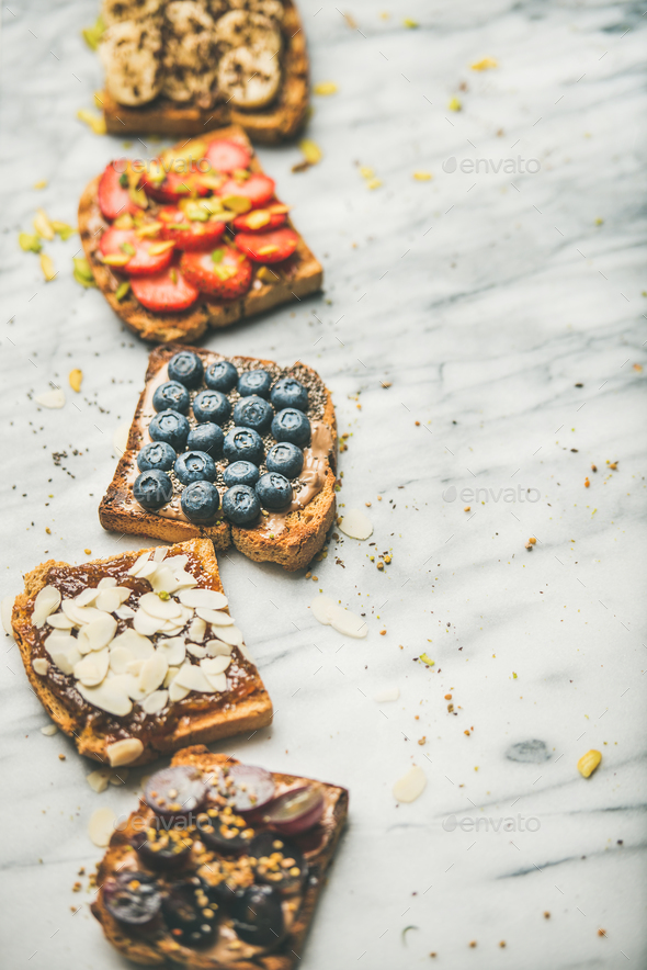 Vegan whole grain toasts with fruit, seeds, nuts - Stock Photo - Images