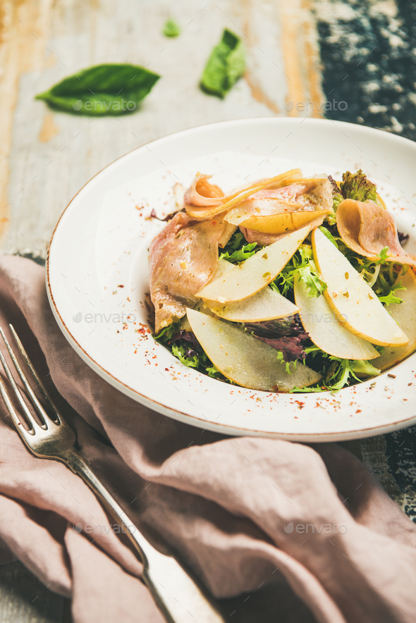 Summer salad with smoked turkey ham and pear slices - Stock Photo - Images