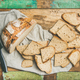 Flat-lay of sourdough wheat bread cut in slices in tray - PhotoDune Item for Sale