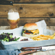 Beef burger, french fries, salad and glass of beer - PhotoDune Item for Sale